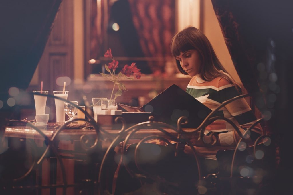 a woman looking at the menu